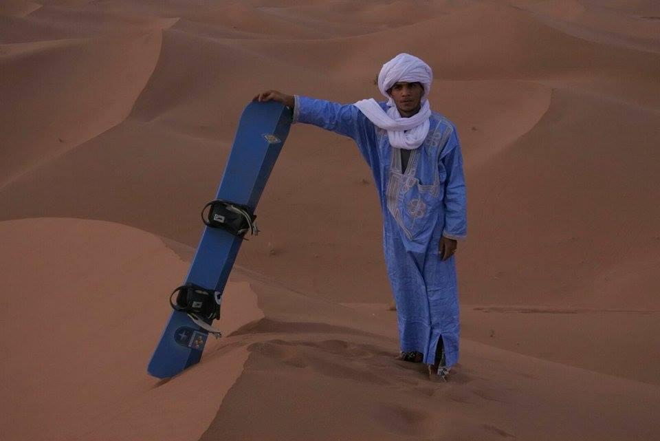 Sandboarding in the Sahara Desert, Morocco