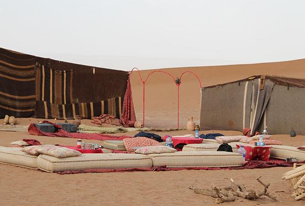 Nomad camp in Sahara sand dunes